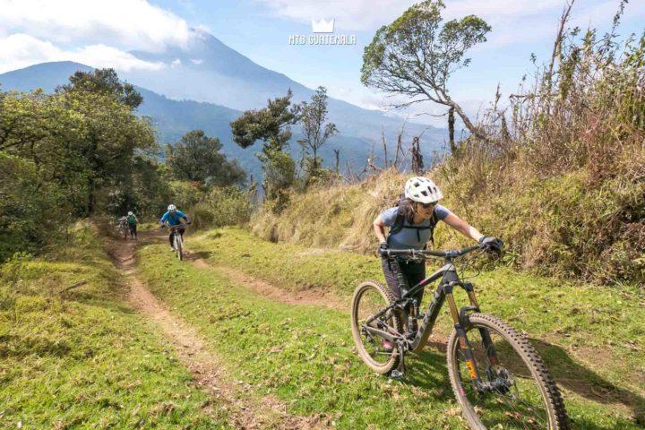 Hiking a bike on the traverse to Tecpán - Volcán Acatenango (3976m) behind.  Valle Escondido Adventure MTB Tour  Chimaltenango, Guatemala