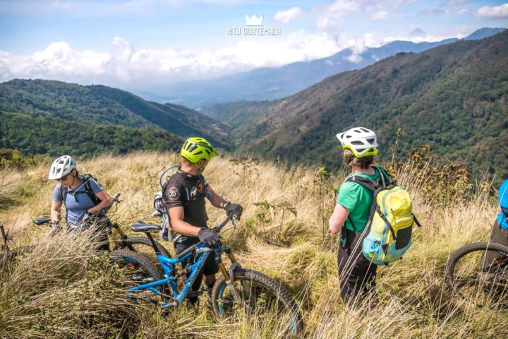 Taking in the views from the alpine plateau - looking west towards the Pacific. Valle Escondido Adventure MTB Tour.  Chimaltenango, Guatemala