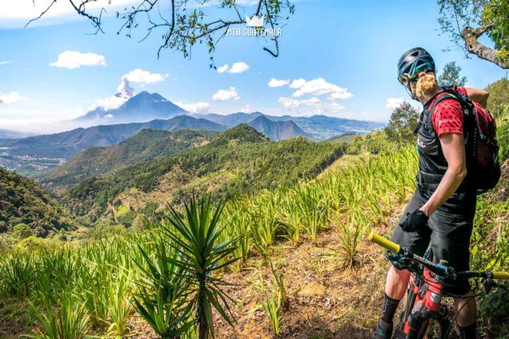 Impressvie panoramas and errupting Volcán de Fuego. Rider: Emilly Sabelhaus. Panorama Sacatepéquez, Guatemala