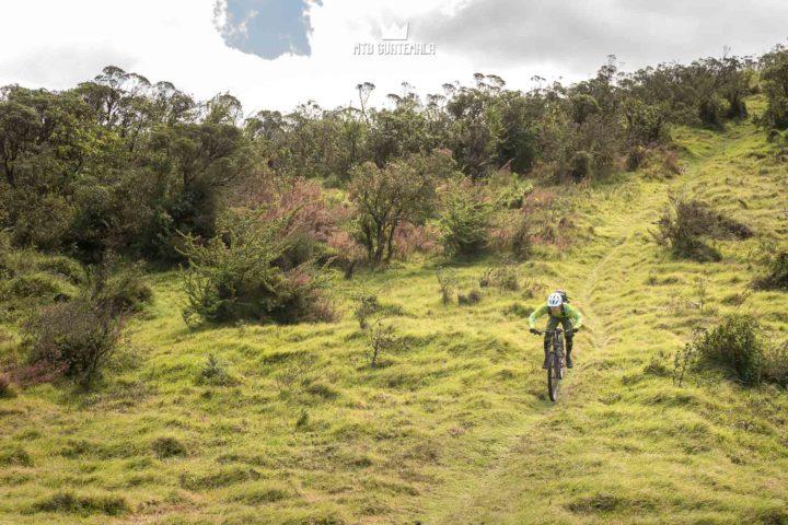 Riding in the alpine Grass.  Valle Escondido Adventure MTB Tour  Chimaltenango, Guatemala