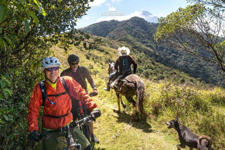 Farmer heads to the fields. Volcán Acatenango (3976m)  behind.  Valle Escondido Adventure MTB Tour  Chimaltenango, Guatemala