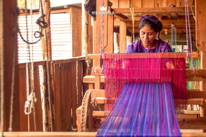 Woman weaves on a hand built loom. Lake Atitlán Solola, Guatemala