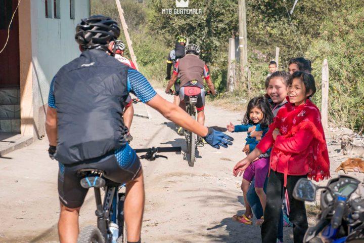 Communities come out to cheer the riders on in the 9th for the 9th edition of the Travesía de Los Cuchumatanes. comunidad san sebastian martir Huehuetenango, Guatemala