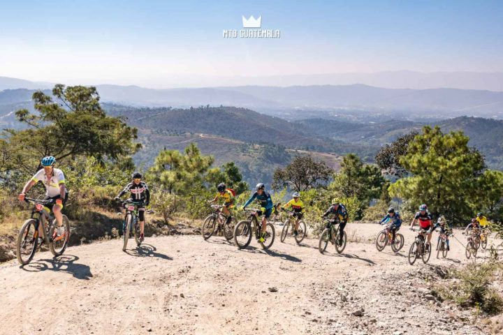 Riders make thier way up the 4,000ft climb with views of northern Guatemala Below.  Huehuetenango, Guatemala