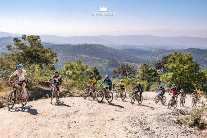 Riders make thier way up the 4,000ft climb with views of northern Guatemala Below.  Huehuetenango, Guatemala