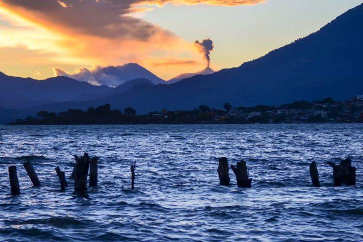 Errupting fuego volcano as seen from Lake Atitlán Lake Atitlán , Guatemala