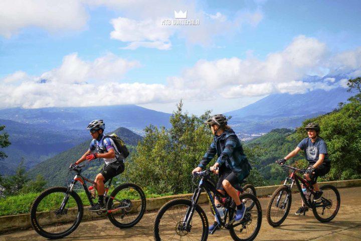 Mountain Bikng to the Sumpango Giant Kite Festival.  Sacatepéquez, Guatemala