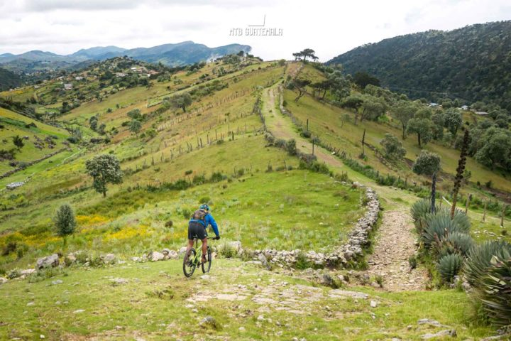 Mountain Biking in the Cuchumatánes - Following rocky sheep herding paths on the alpine plateau.  Trails here are lined with enormous agave plants. Los Cuchumatánes Huehuetenango, Guatemala
